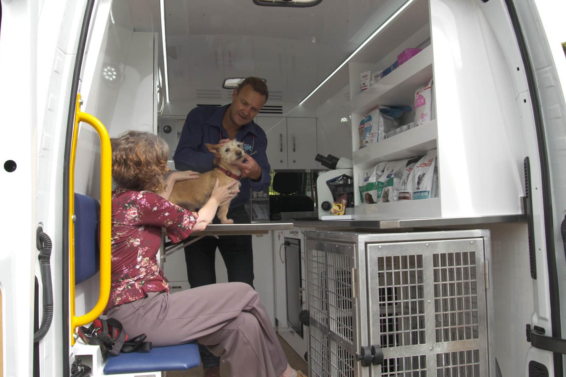 PETstock Vet consulting pet parent in Mobile Vet van